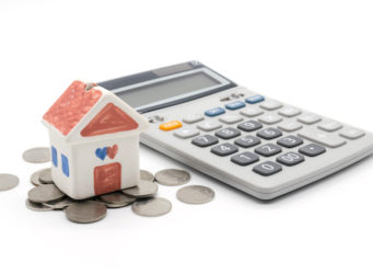 House and calculator on white background